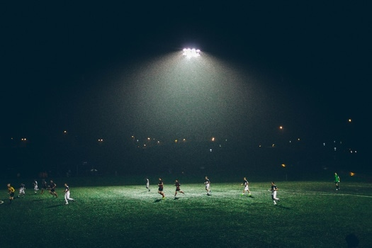 People Playing Soccer during Nighttime