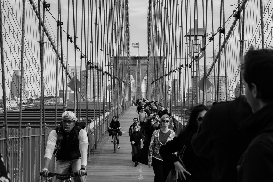 Grayscale Photo of People Walking on a Bridge during Daytime