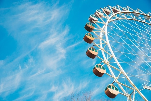 Cloudy Blue Sky over Ferris Wheel