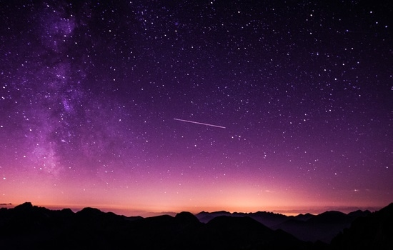 Shooting Star during Nighttime With Purple Sky