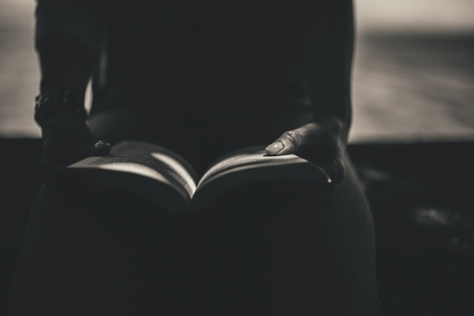 Person Sitting While Open the Book