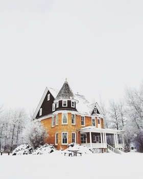 Black and Brown House in the Middle of Snow