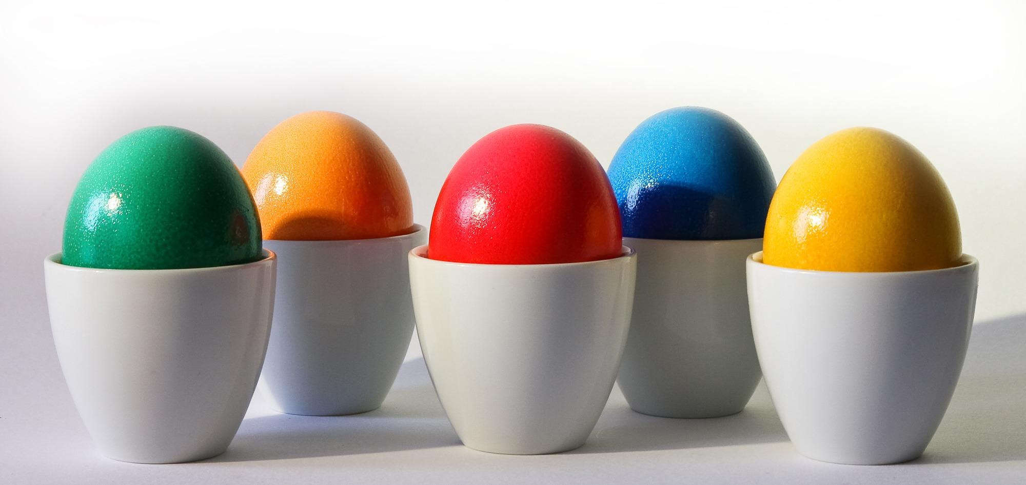 multicolored egg ornament on white desk free stock photo