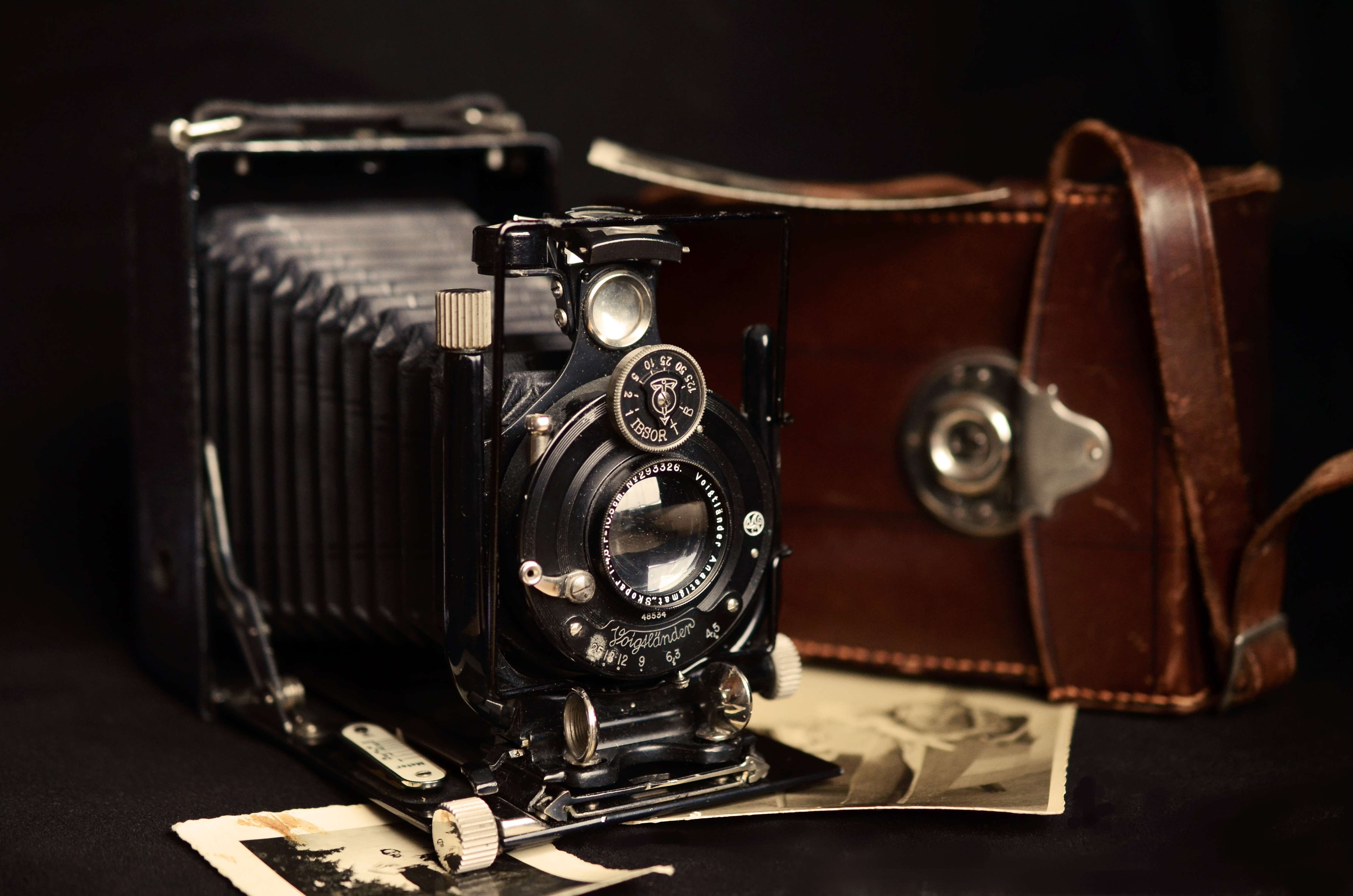 Black Classic Camera Near Brown Leather Bag · Free Stock Photo
