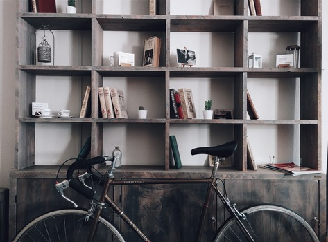 Brown Road Bicycle in Front of Gray Wooden Shelf Cabinet