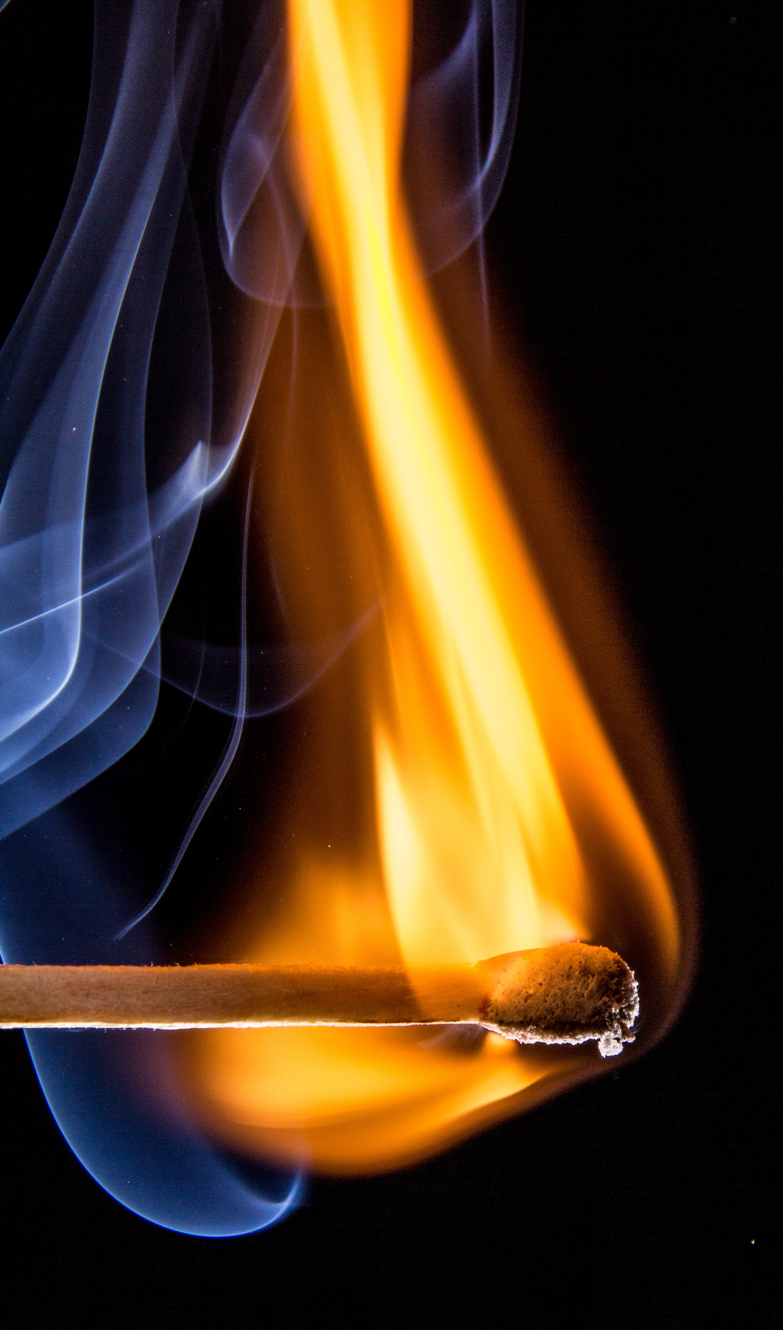 match stick give orange fire with a white smoe free stock photo