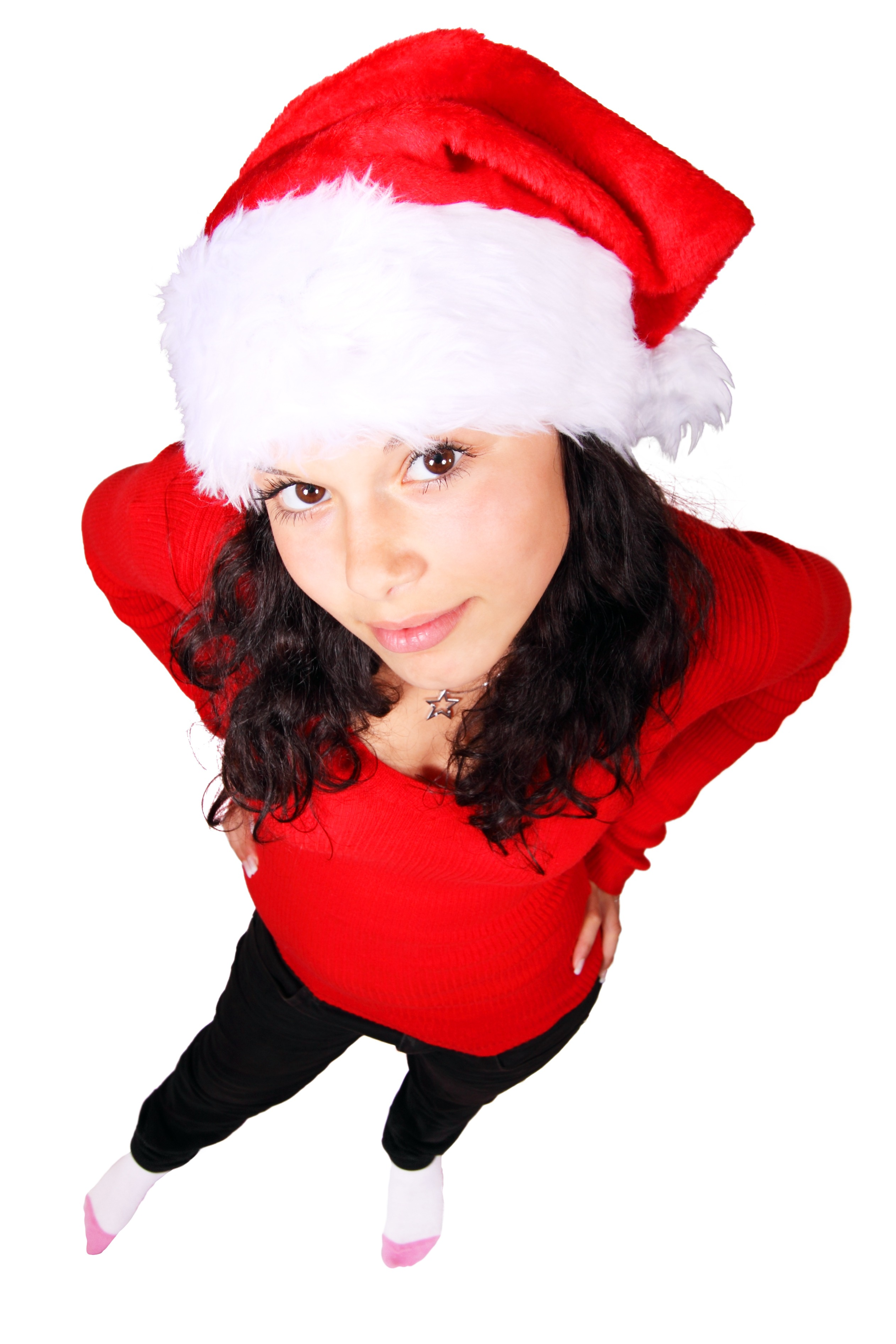 woman standing wearing red scoop neck long sleeve shirt and santa