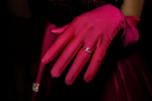 Person in Red Glove With Silver Ring