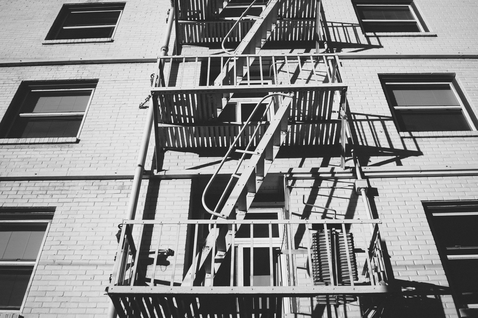 Apartment Building Fire Escape Ladder free stock photo of black-and-white, emergency, fire escape