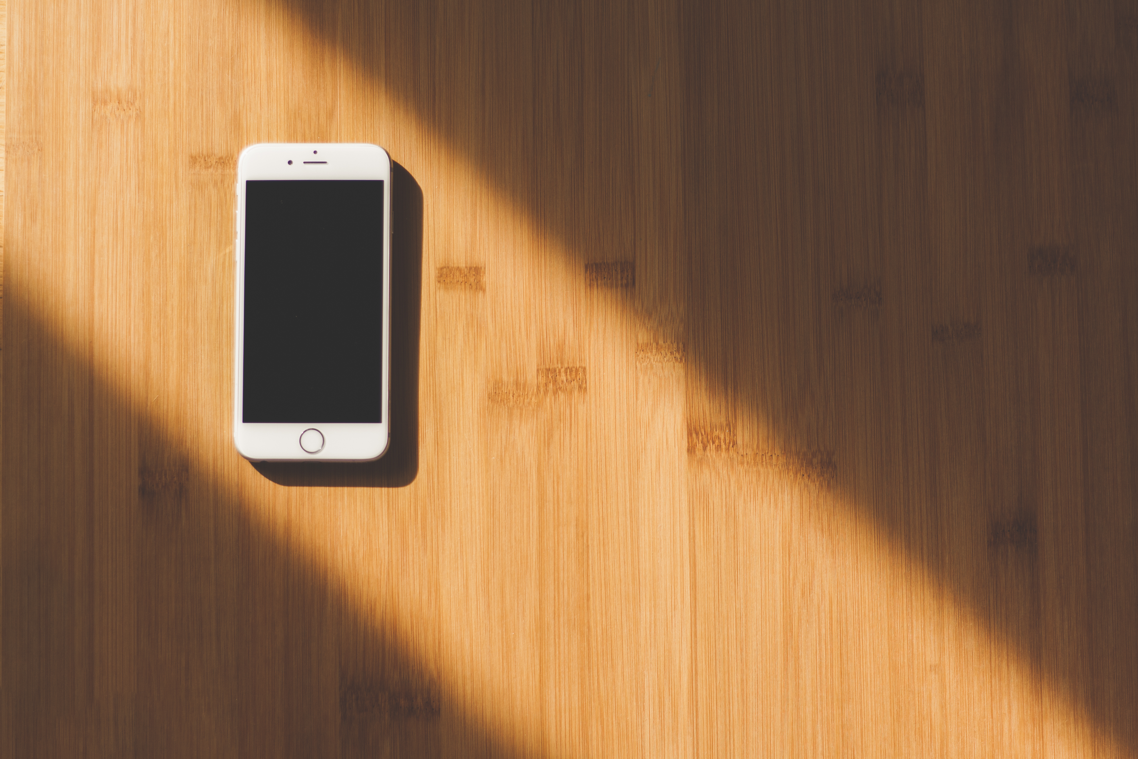 White Apple Iphone On Wooden Table 183 Free Stock Photo