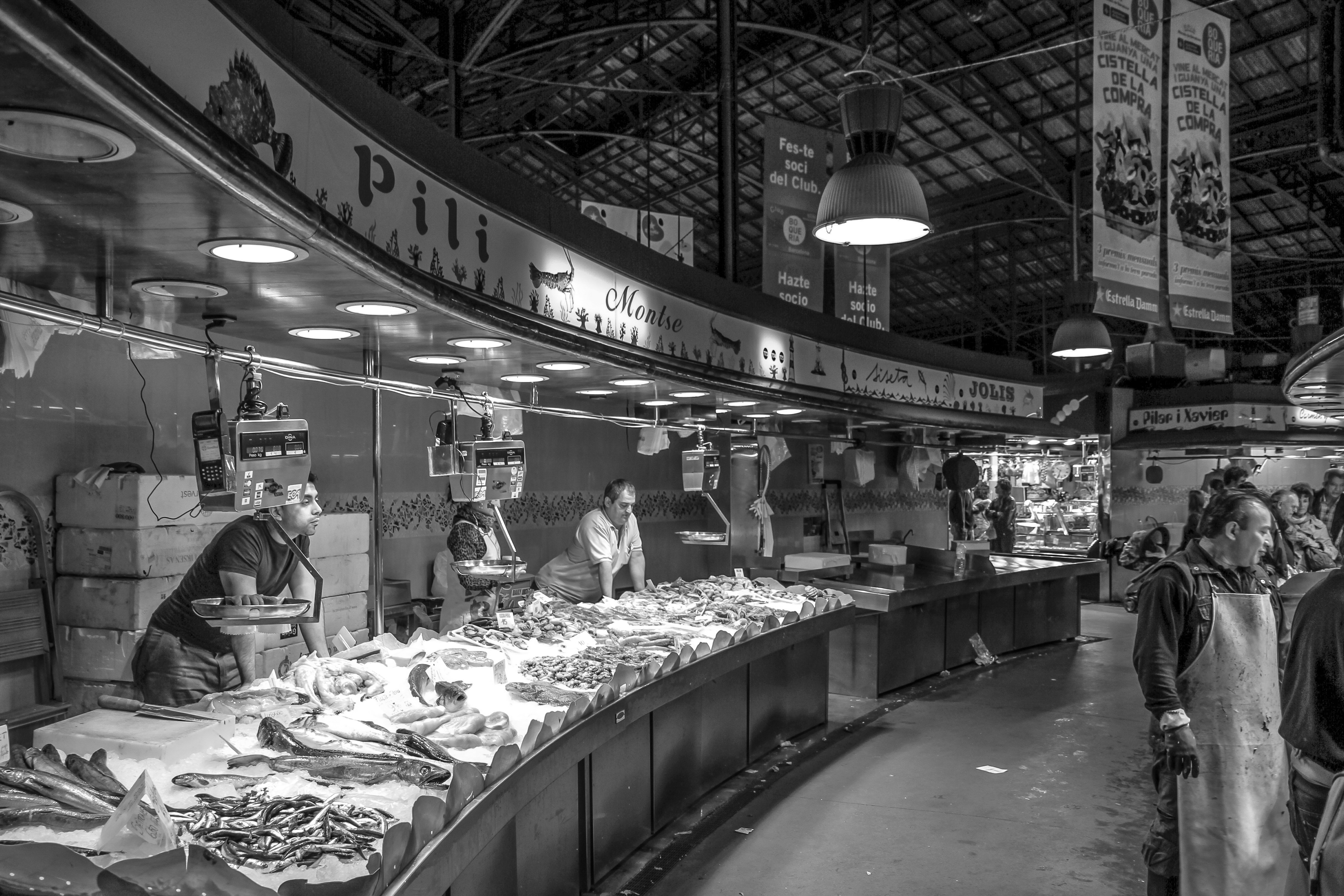 Gray scale photo of a people in market free stock photo for Seafood fish market