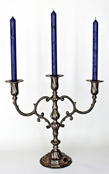 3 Blue Candles on Gray Metal Candle Stand
