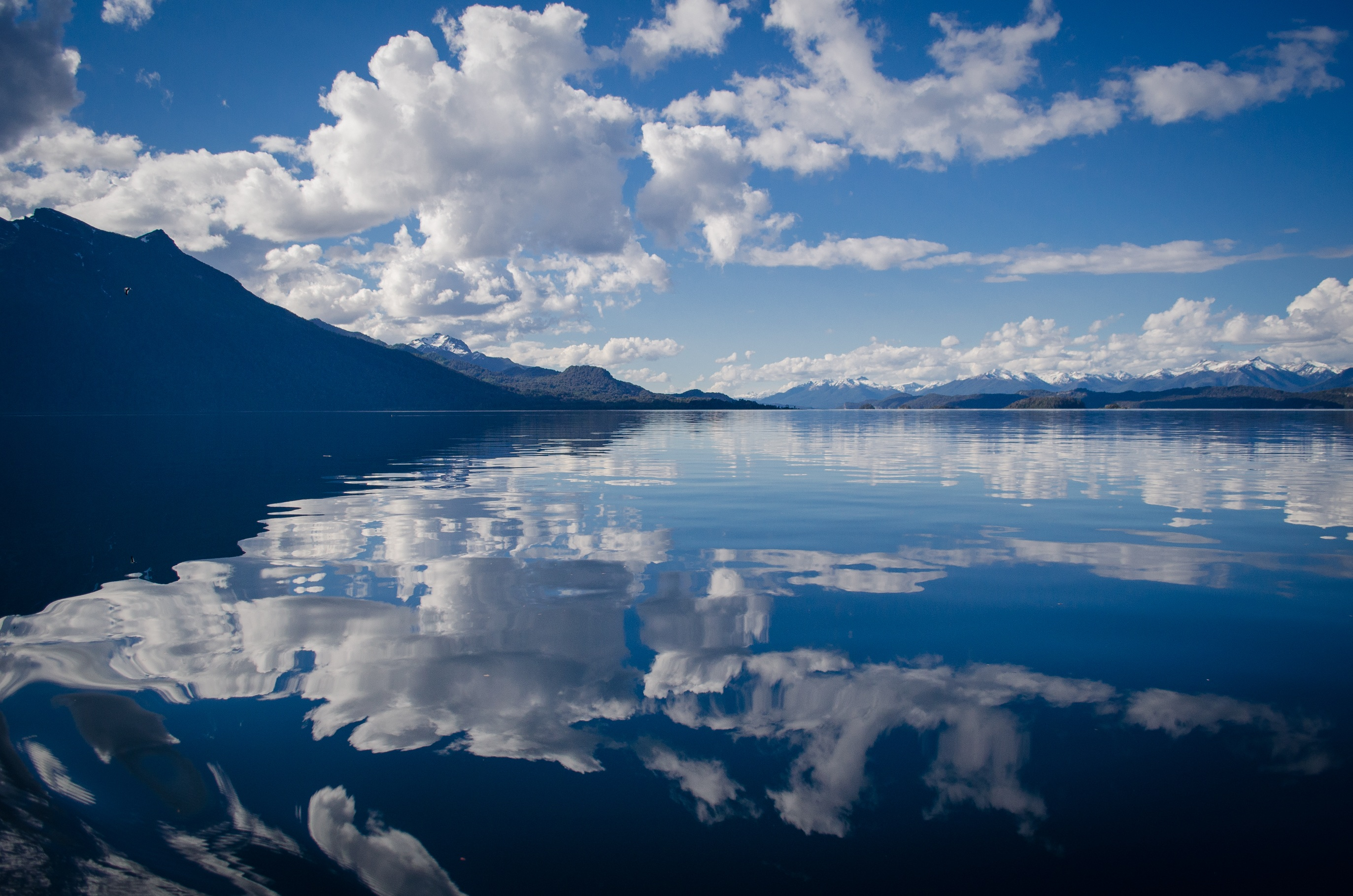 Lake Water Under White and Blue Skies during Daytime · Free Stock ... Reflection