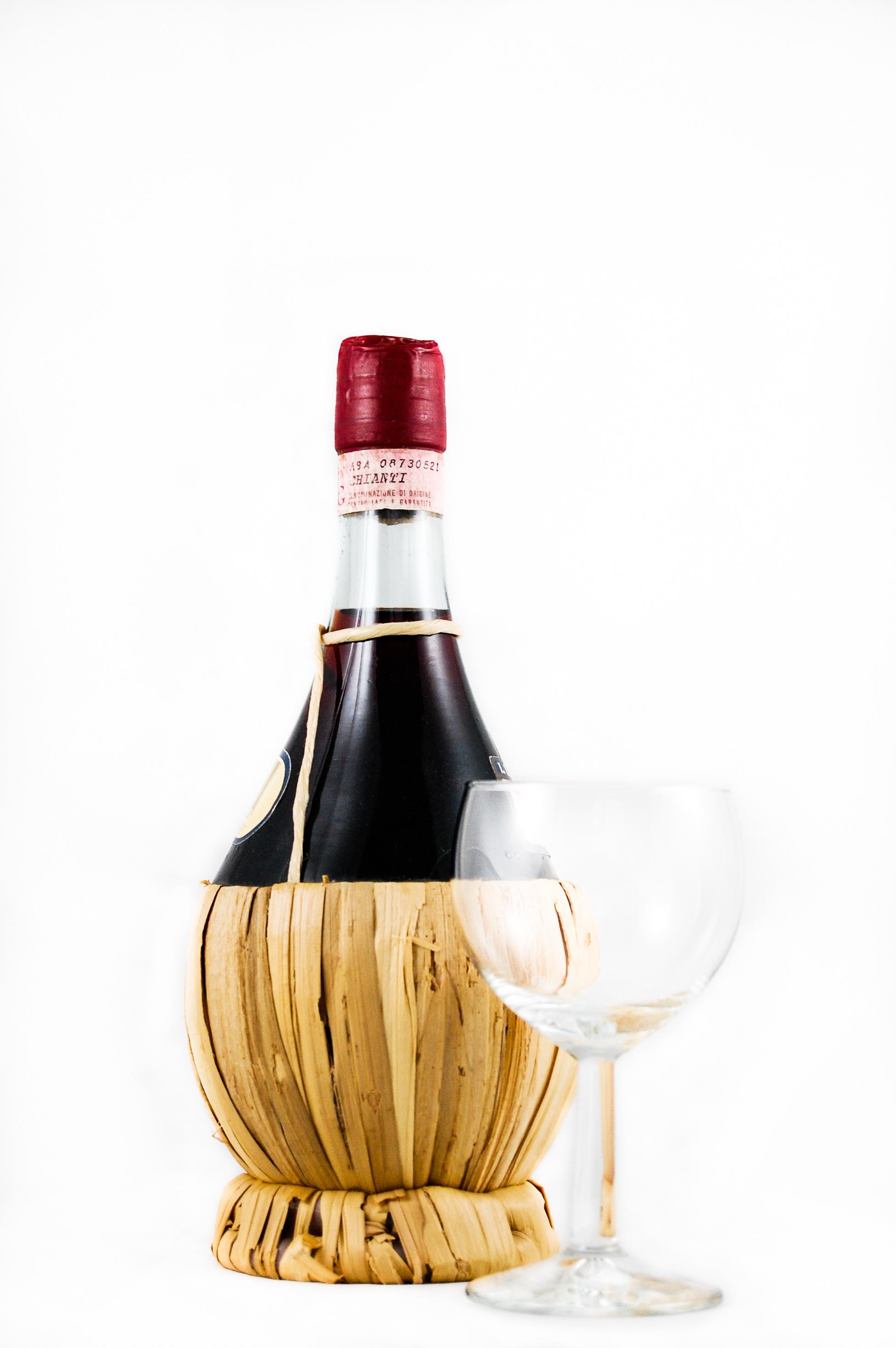 Clear wine glass beside red wine bottle free stock photo for Wine bottle glass
