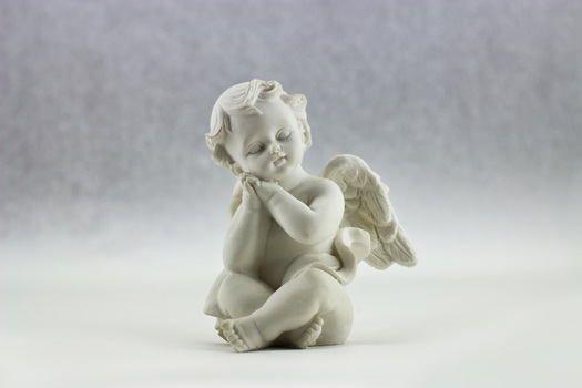 White Ceramic Figurine of Angel Illustration