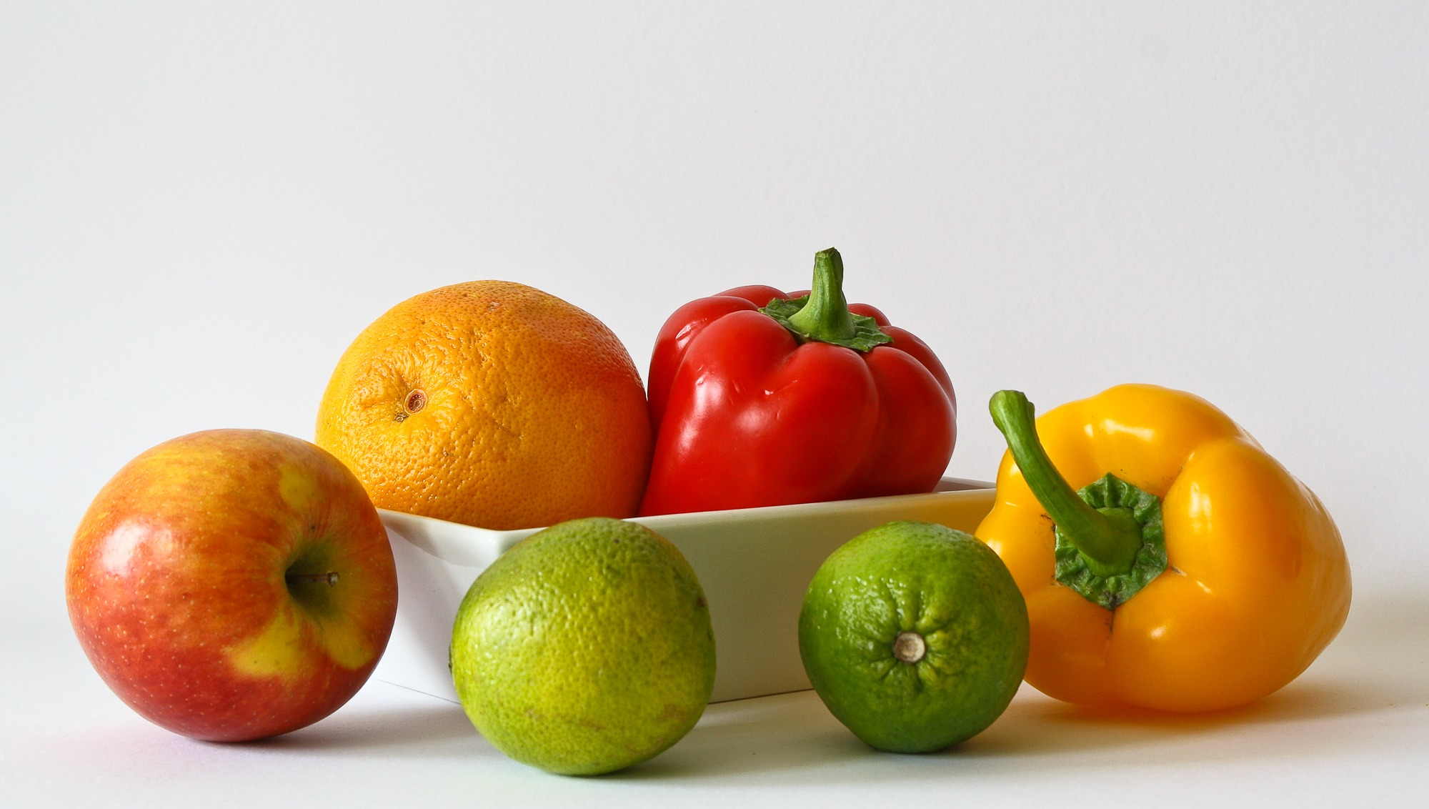 red apple fruit near red bell pepper free stock photo