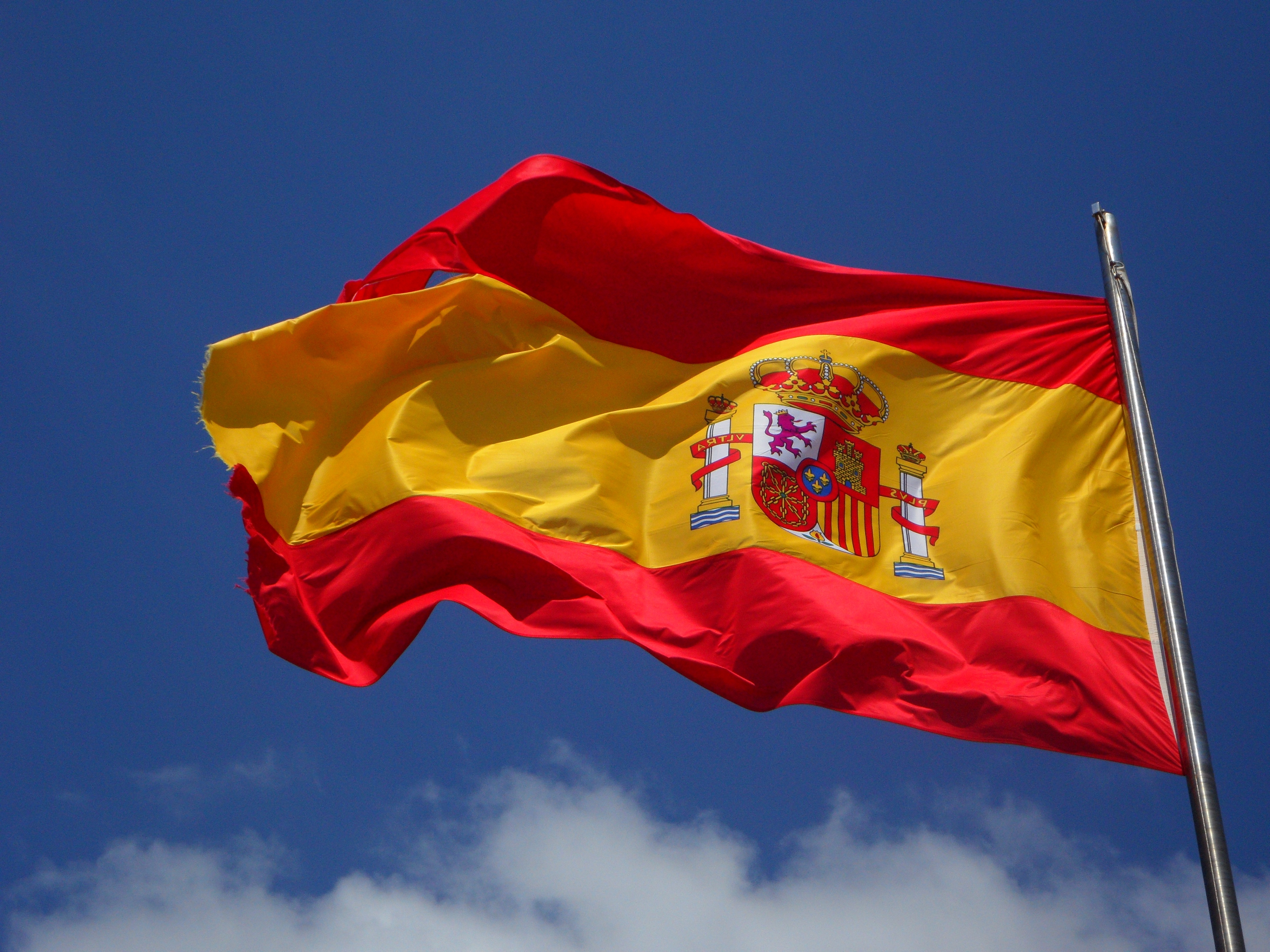 spain flag in pole free stock photo