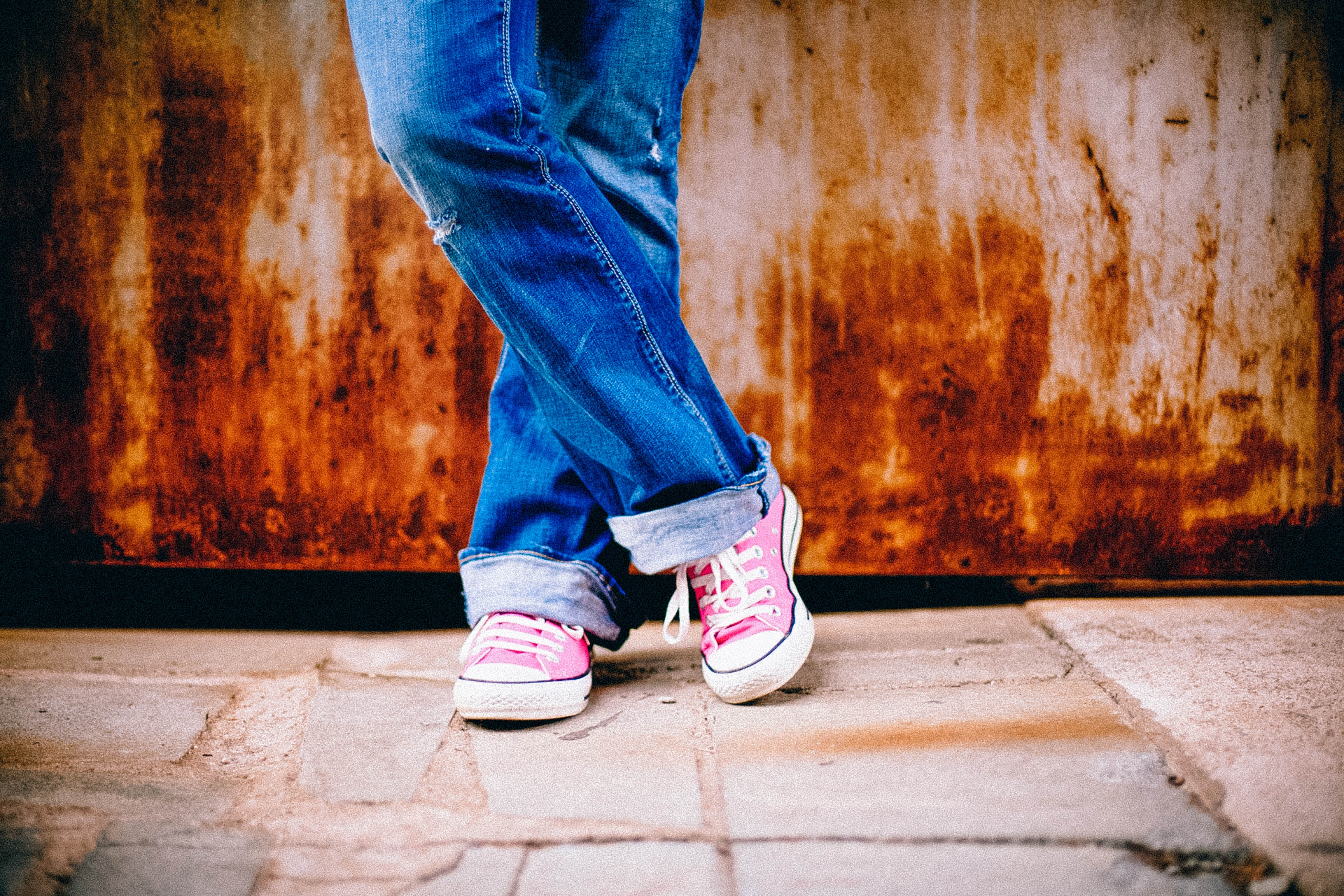 Converse Shirt Size Chart: Person in Blue Jeans and Pink White Converse All Star Sneakers ,Chart