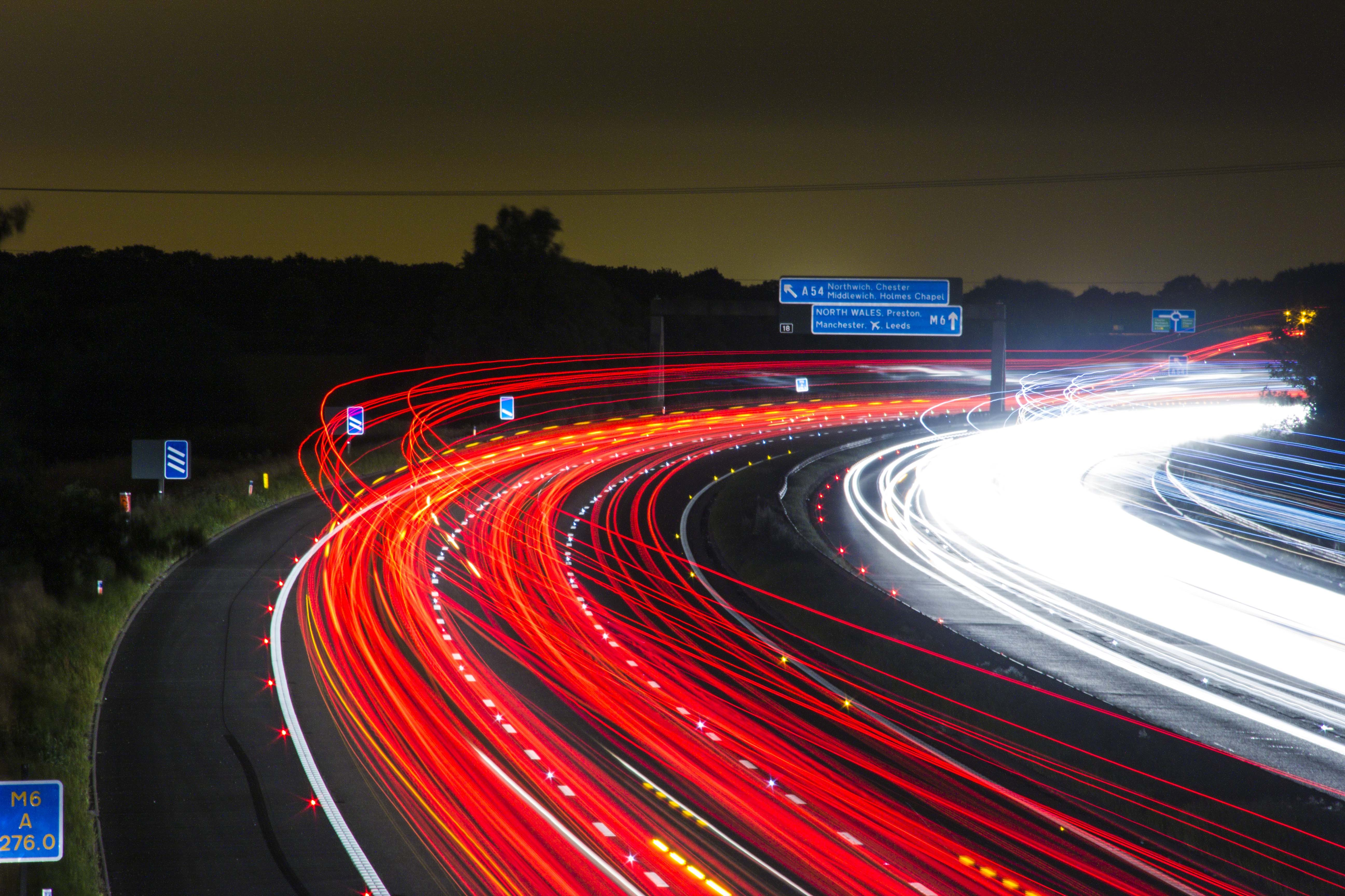 Time Lapse Photography of Car Passing by the Winding Road during ... for Traffic Light On Road At Night  570bof