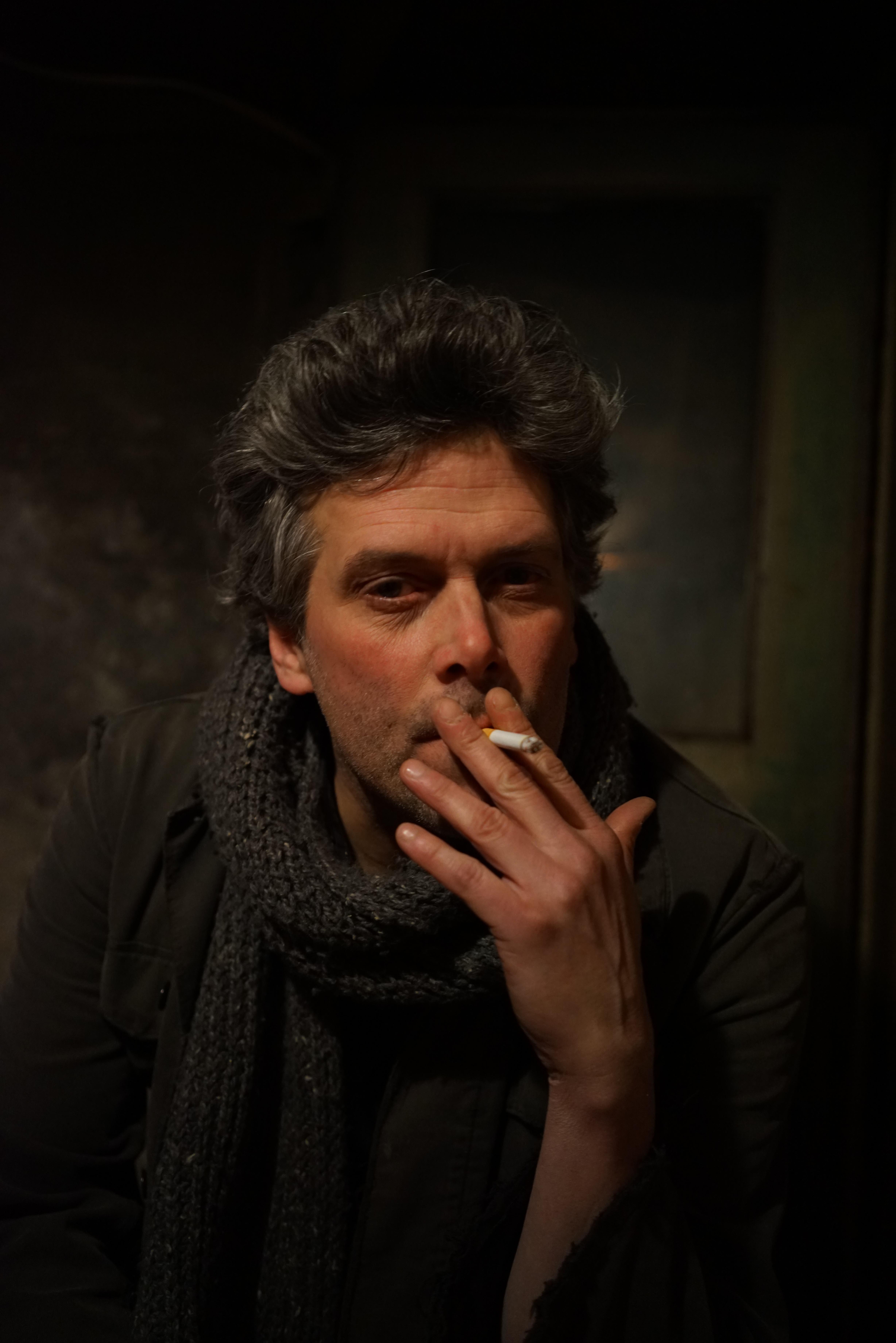 Man In Black Jacket With Gray Knit Scarf Smoking 183 Free