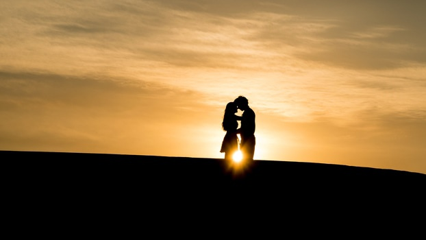 Silhouette of Couple in a Sunset View