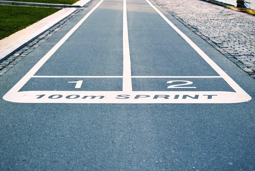 https://www.pexels.com/photo/blue-concrete-pavement-with-100m-sprint-paint-60230/