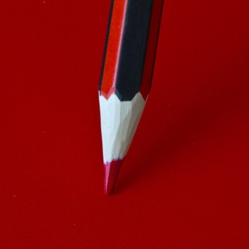 Red Pencil on a Red Surface