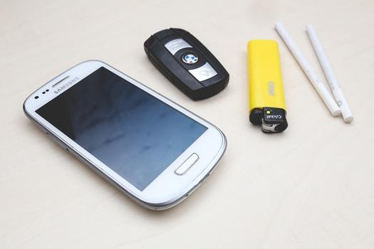 Phone, car key, lighter & cigarettes