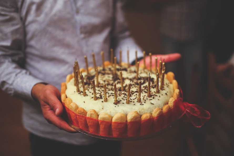 Birthday cake in men's hands