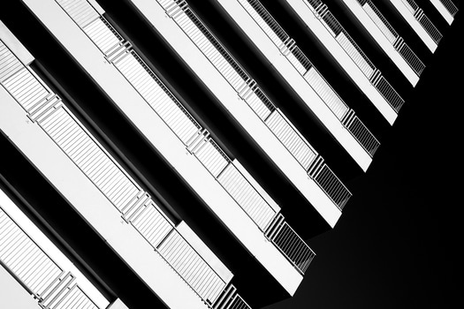White Highrise Building Under the Bright Sky during Daytime