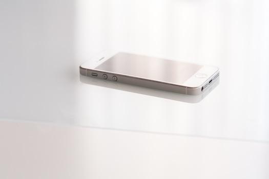 Closeup view of white smart phone. Connectors details.