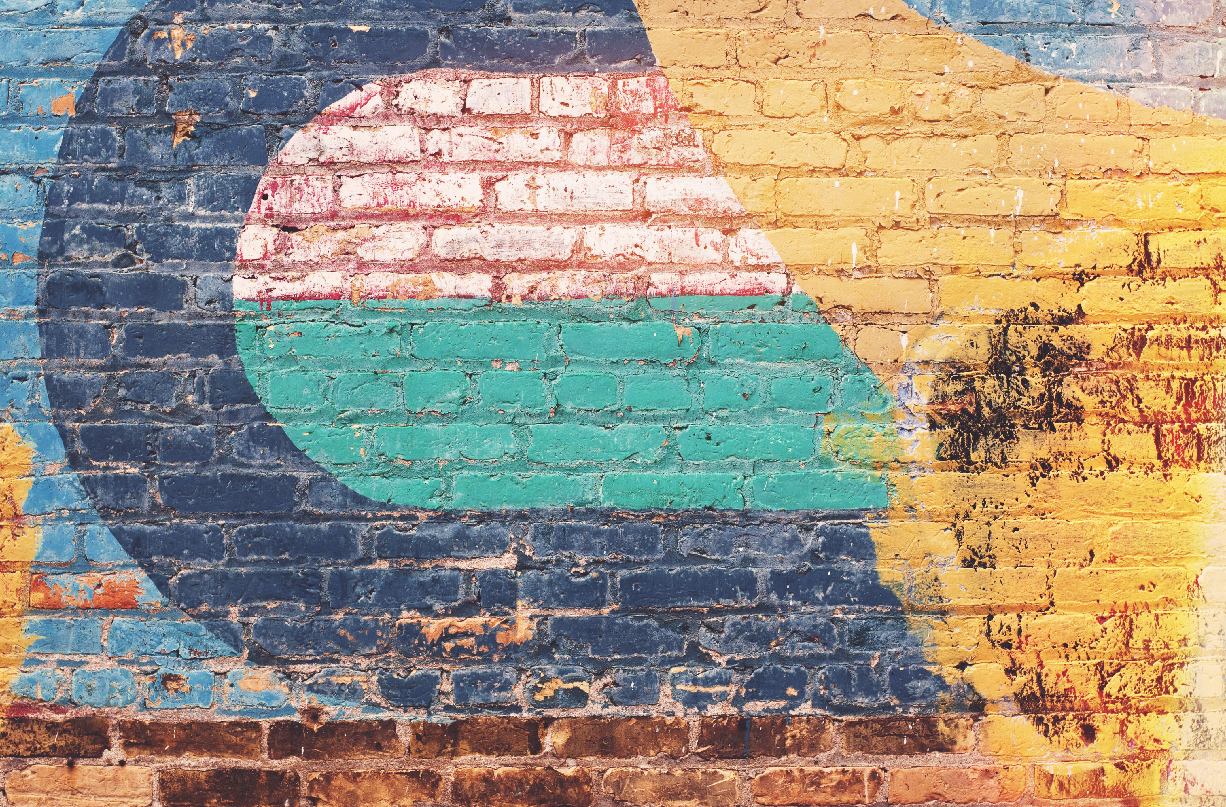 Brick Wall Art yellow green and blue brick wall · free stock photo
