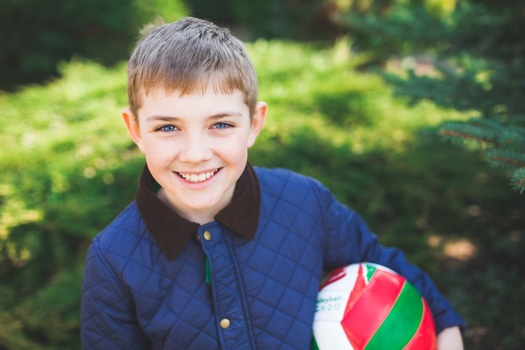 Portrait of a smiling young boy with a ball