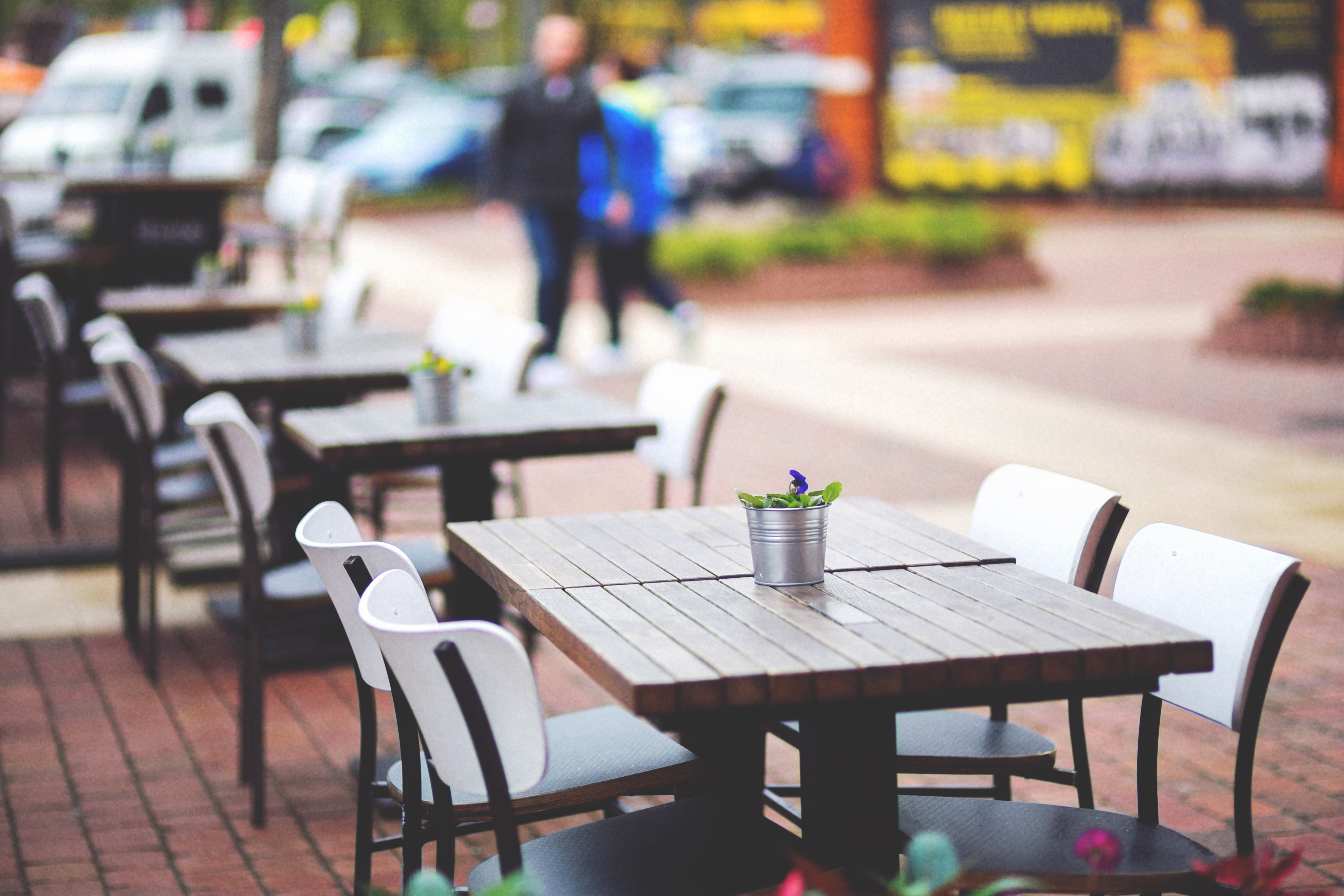 Street view of a coffee terrace with tables and chairs free stock photo - Table professionnel restaurant ...