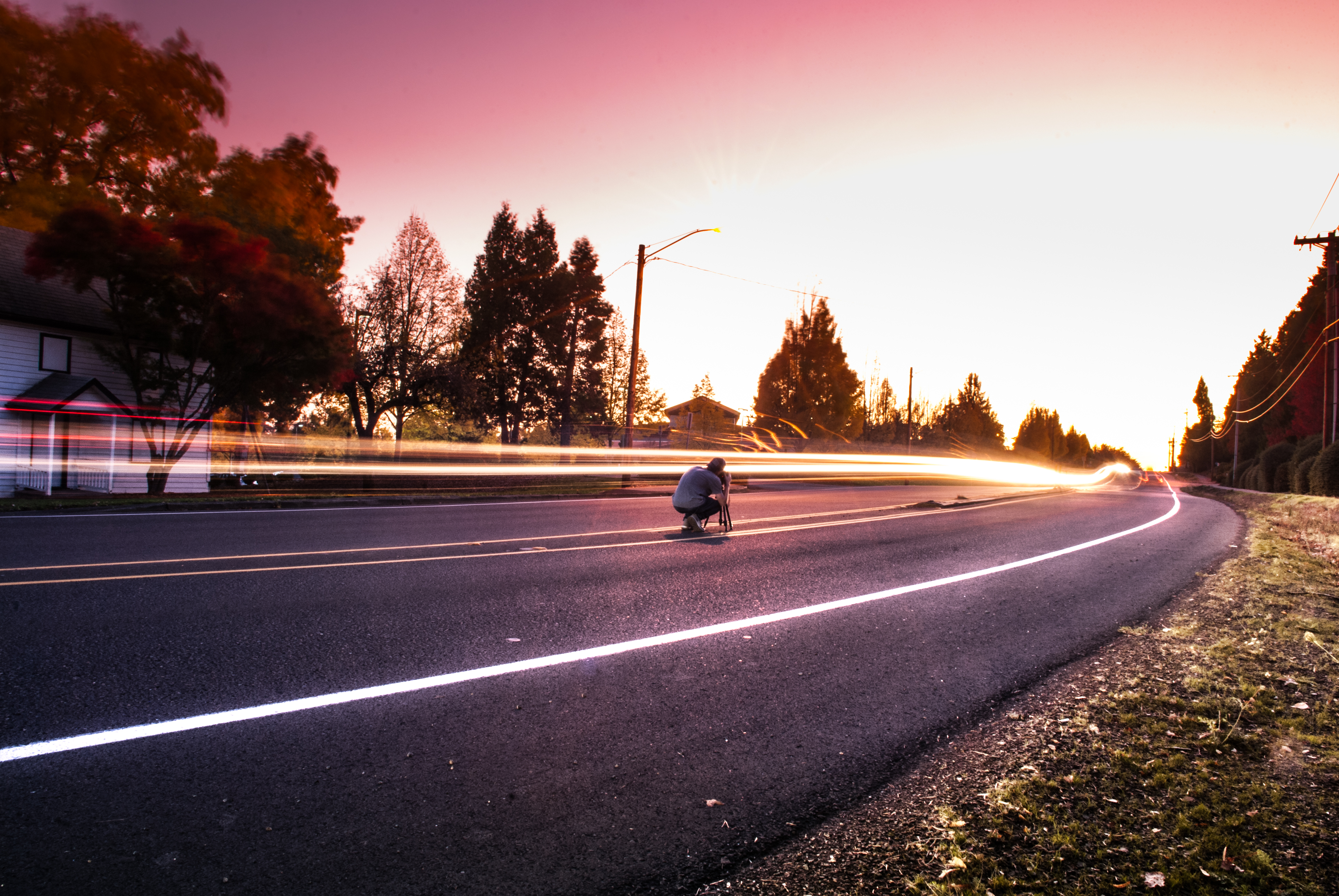 Person Sitting On Black Top Road During Twilight 183 Free