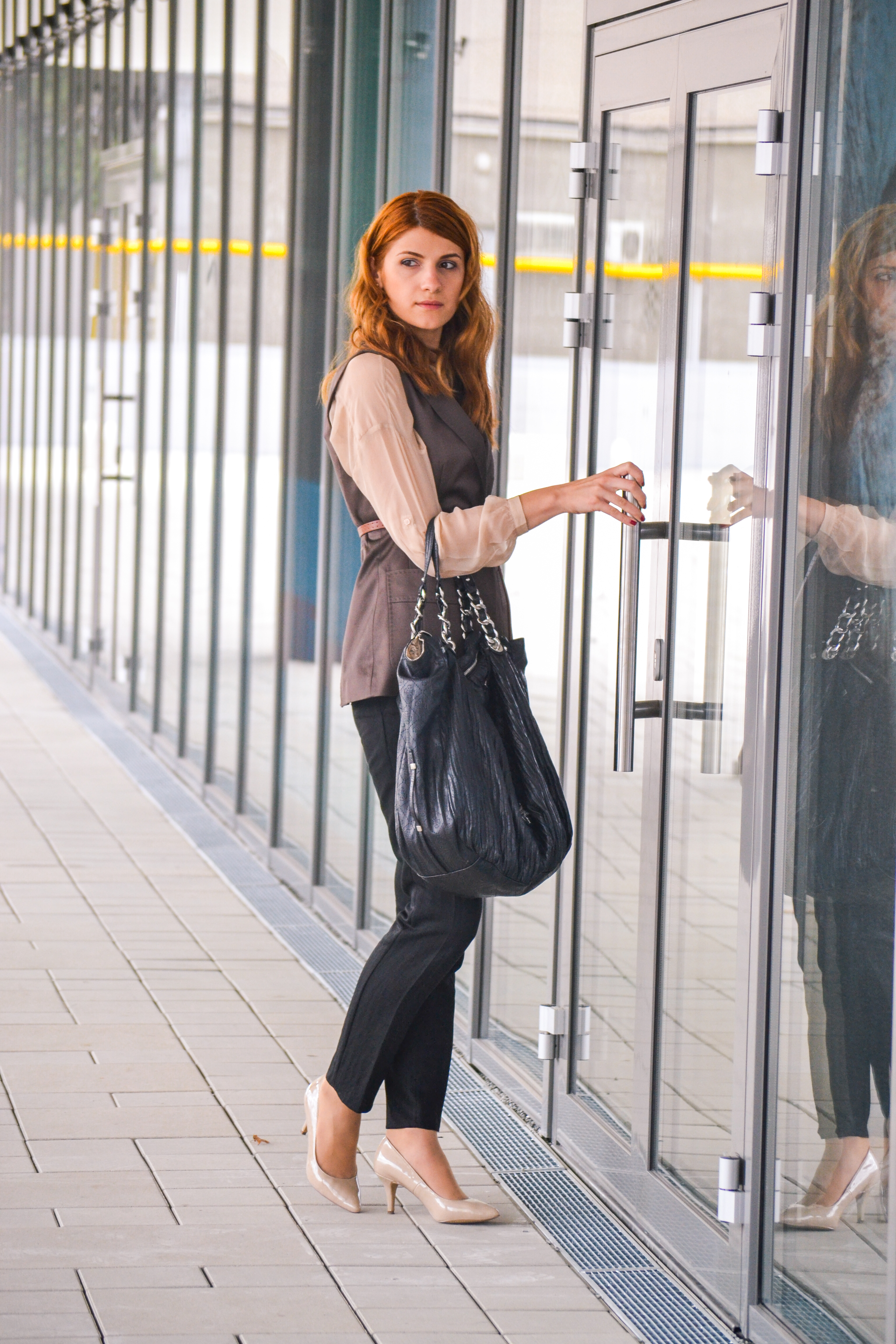 Woman Wearing Black Dress Pants With Black Handbag · Free ...