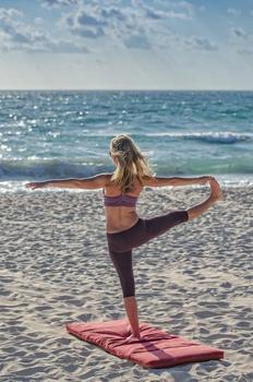 Woman Doing Yuga on Seashore