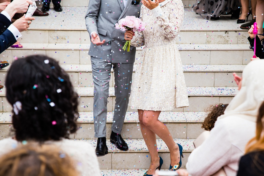 Woman Wearing White Long Sleeve Dress Holding Pink Wedding Bouquet
