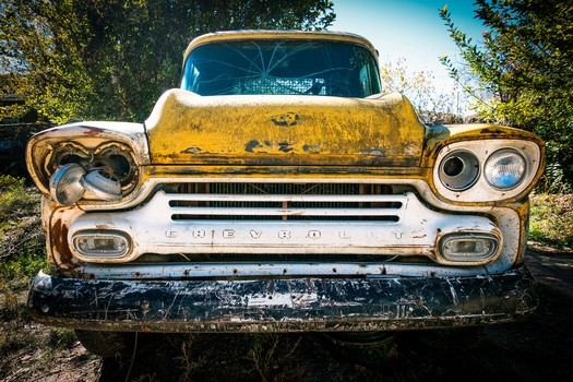 Yellow Chevy Pickup Truck in Low Photography