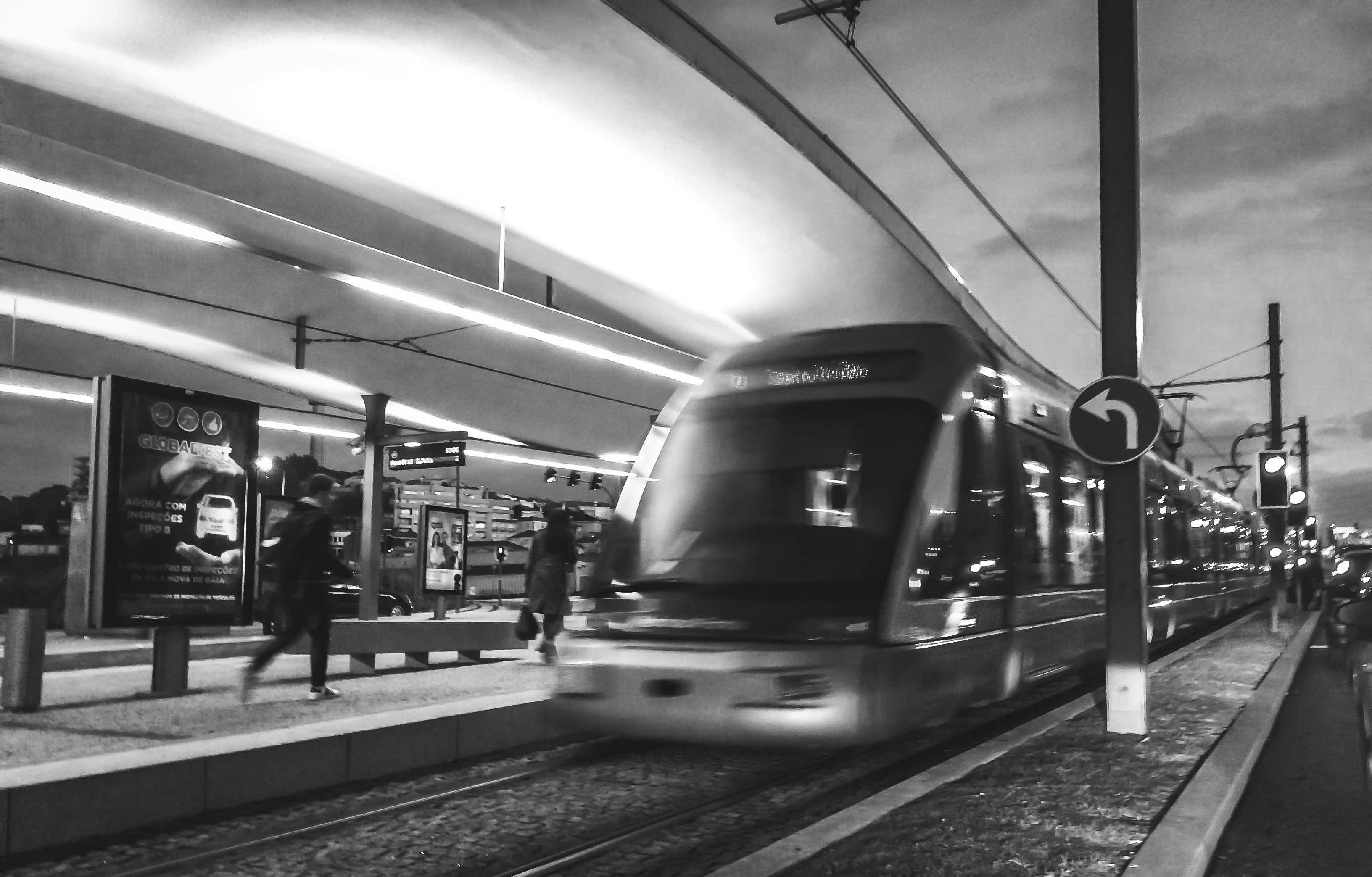 grayscale photography of people near train free stock photo