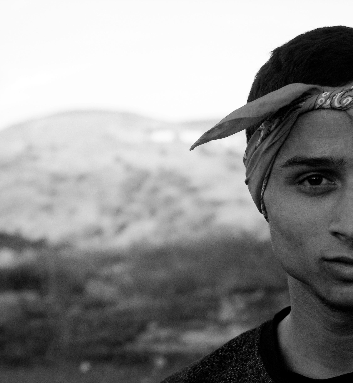 Grayscale Photography Of Man Wearing Bandana · Free Stock