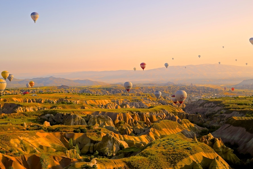 Balloons over mountains