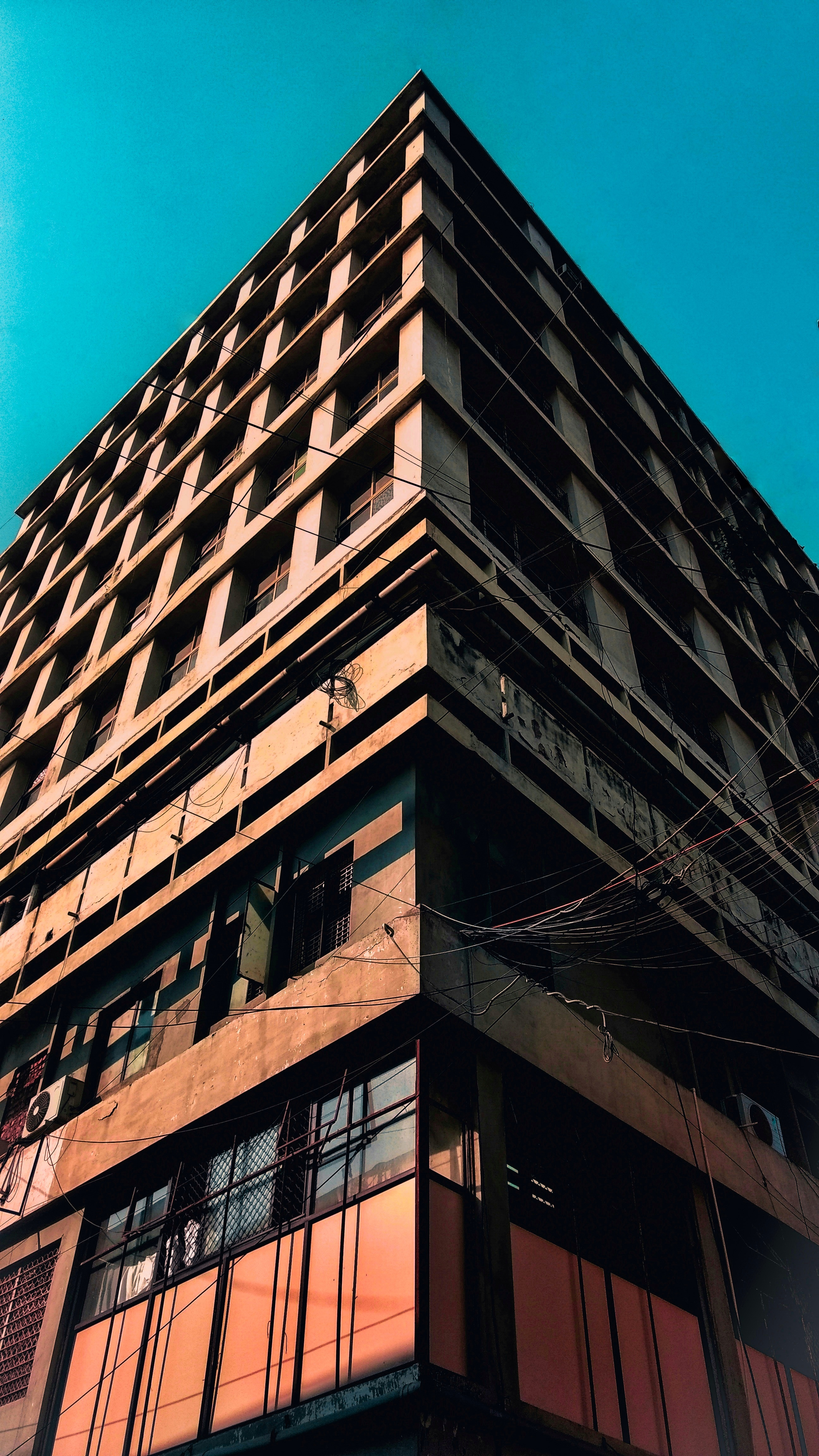 Low Angle Photography Of Building Free Stock Photo: Low Angle Photography Of Brown Concrete Building · Free