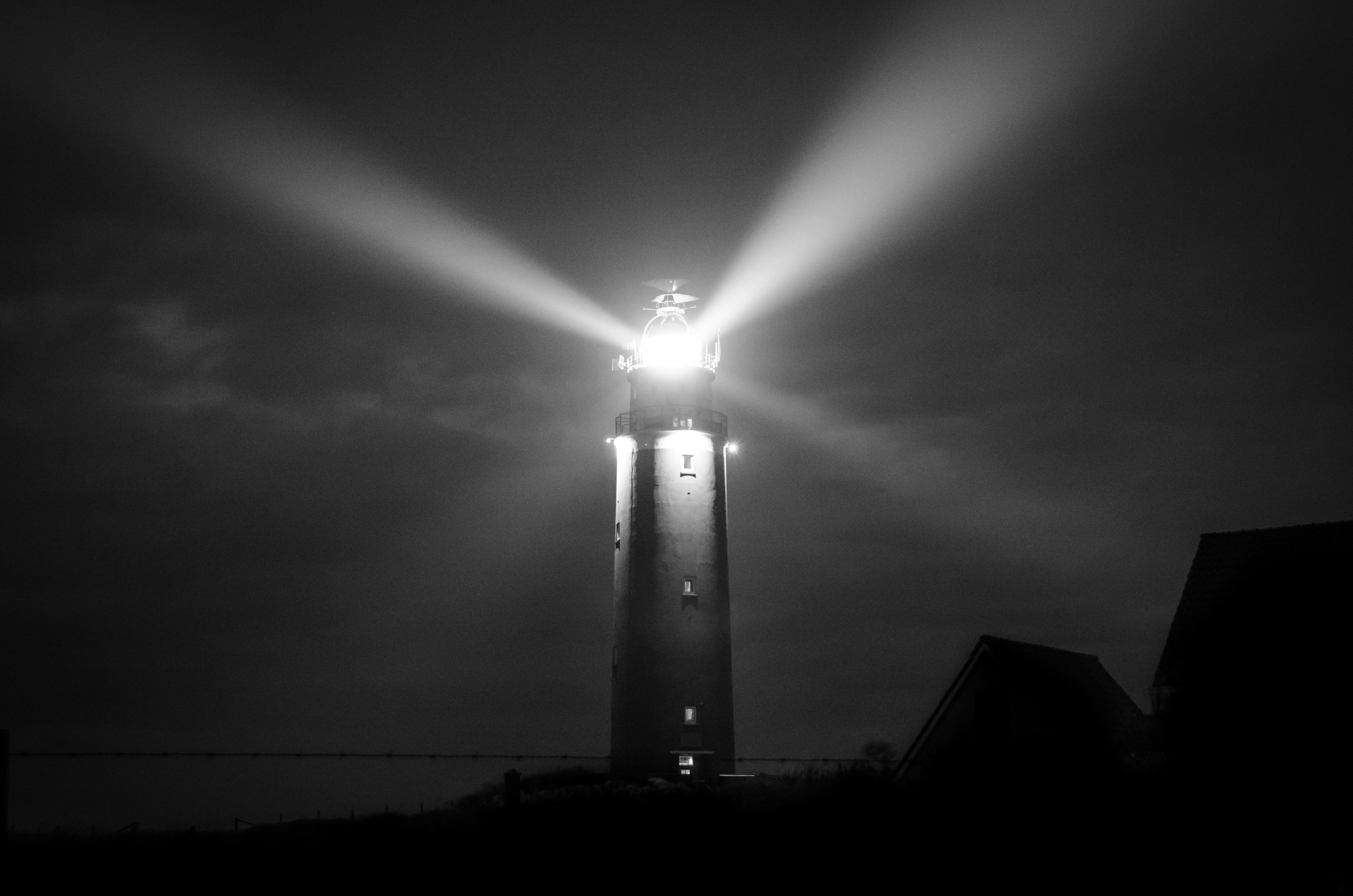Gray Scale Photography of Lighthouse · Free Stock Photo