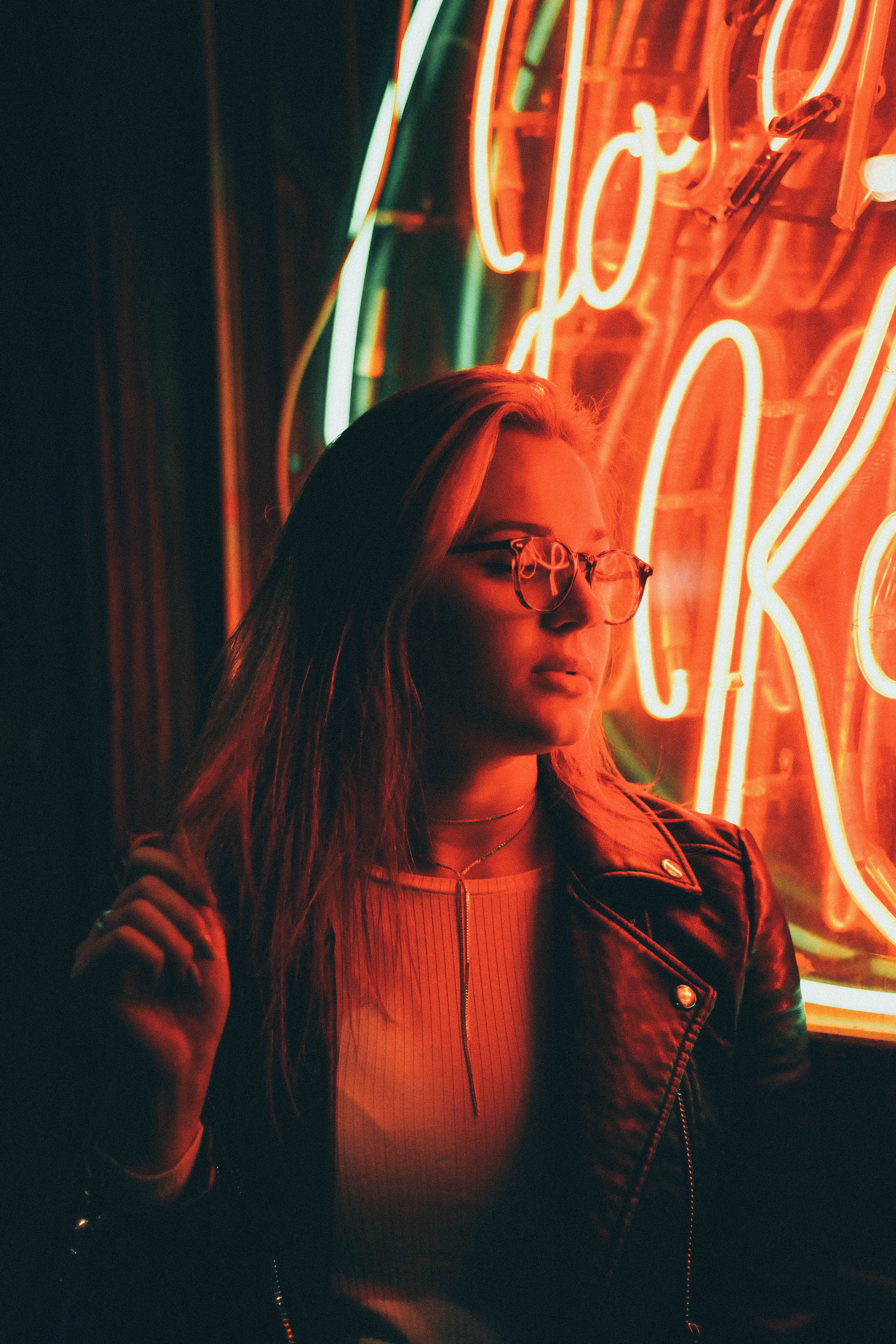 Woman In Denim Jacket Near Neon Signage · Free Stock Photo