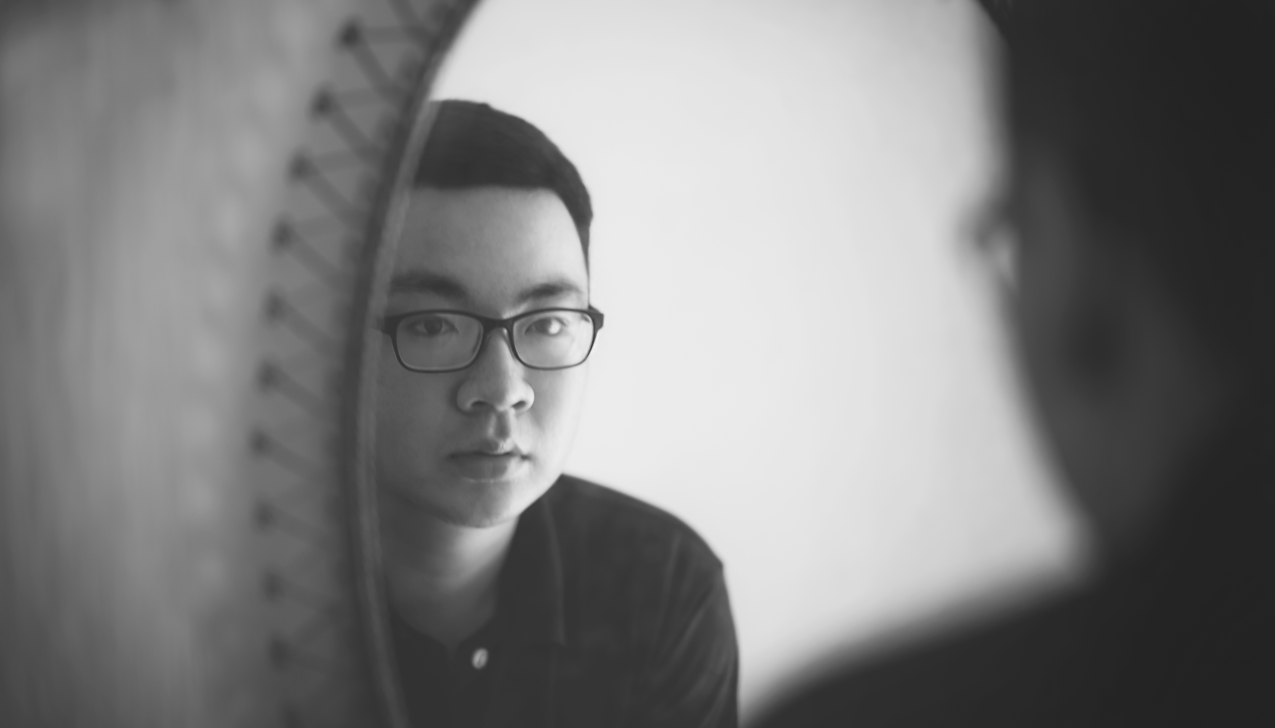 Monochrome photography of a man looking in front of mirror for Mirror reflection