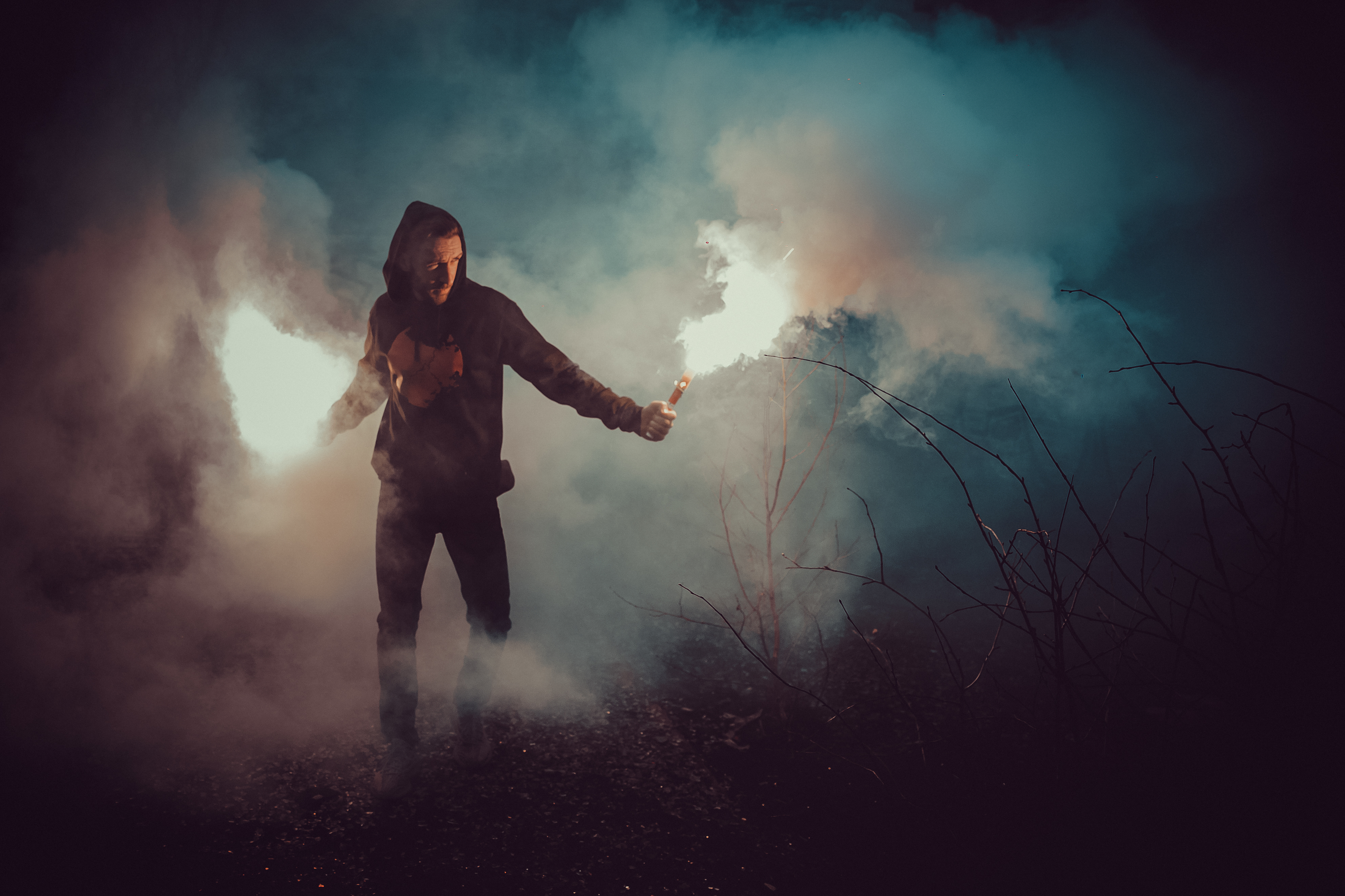 Iso Definition Photography >> Man in Black Hoodie Holding Fire · Free Stock Photo