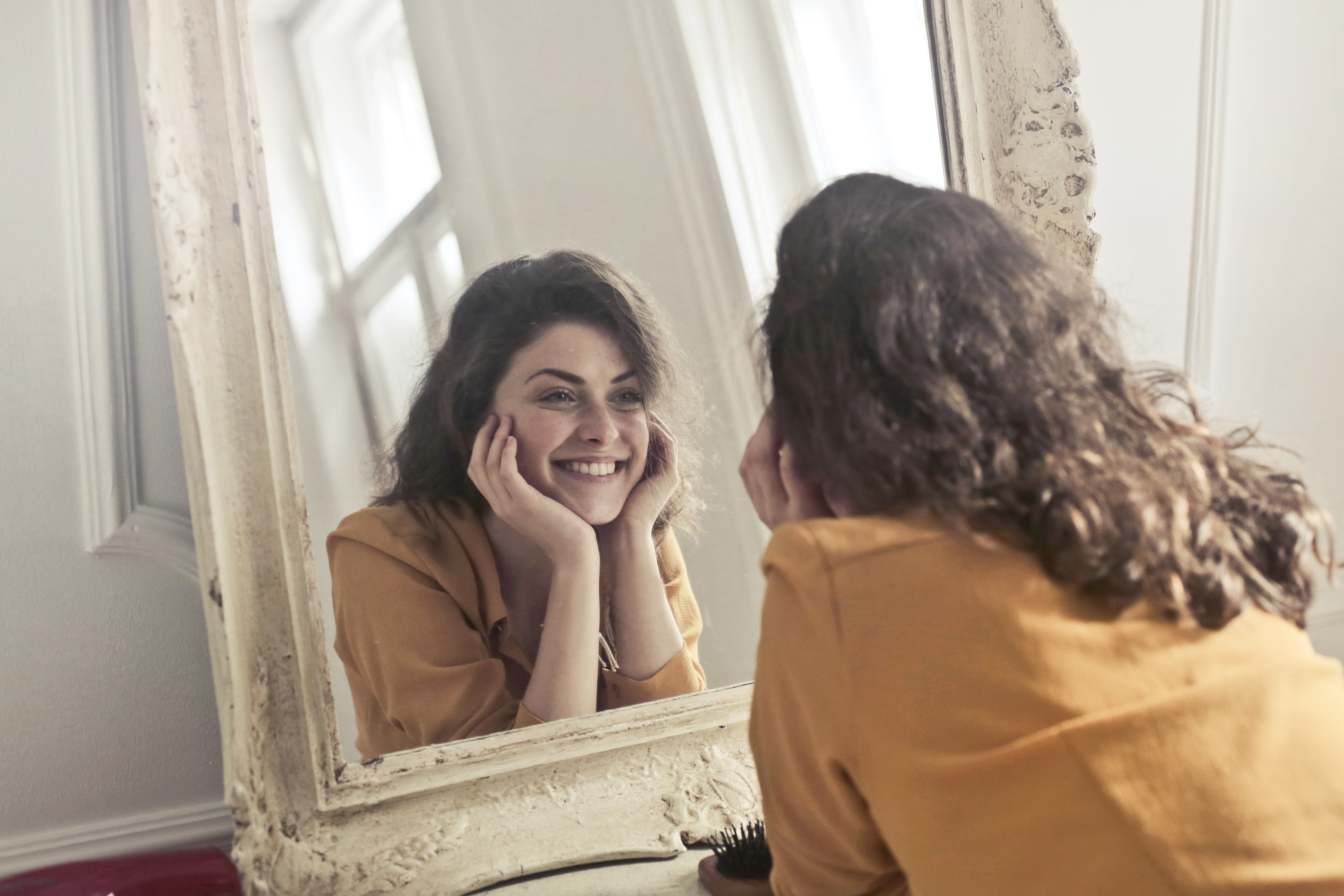 Photo of woman looking at the mirror free stock photo for Mirror that look