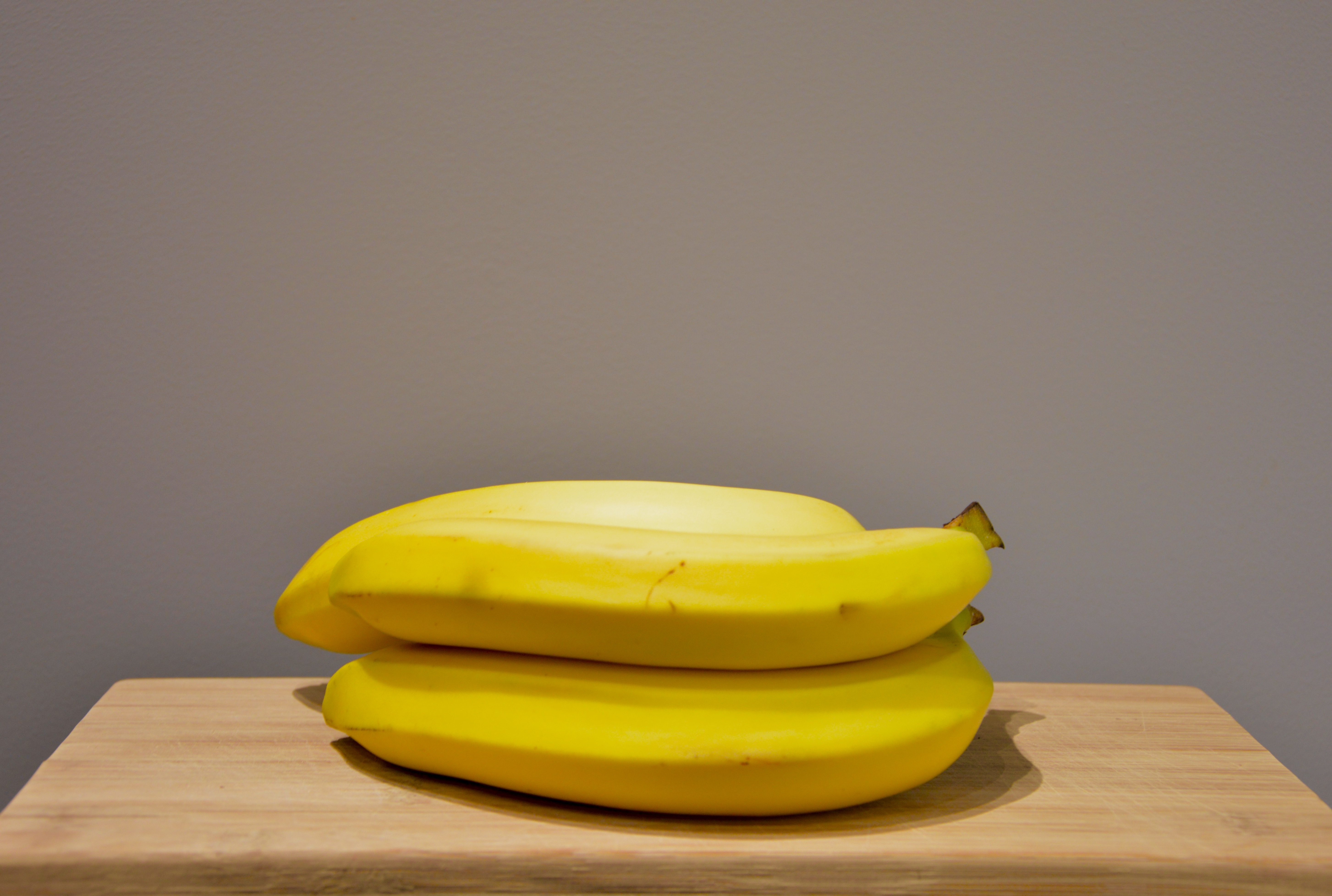 Yellow Bananas On An Oak Wood Table 183 Free Stock Photo