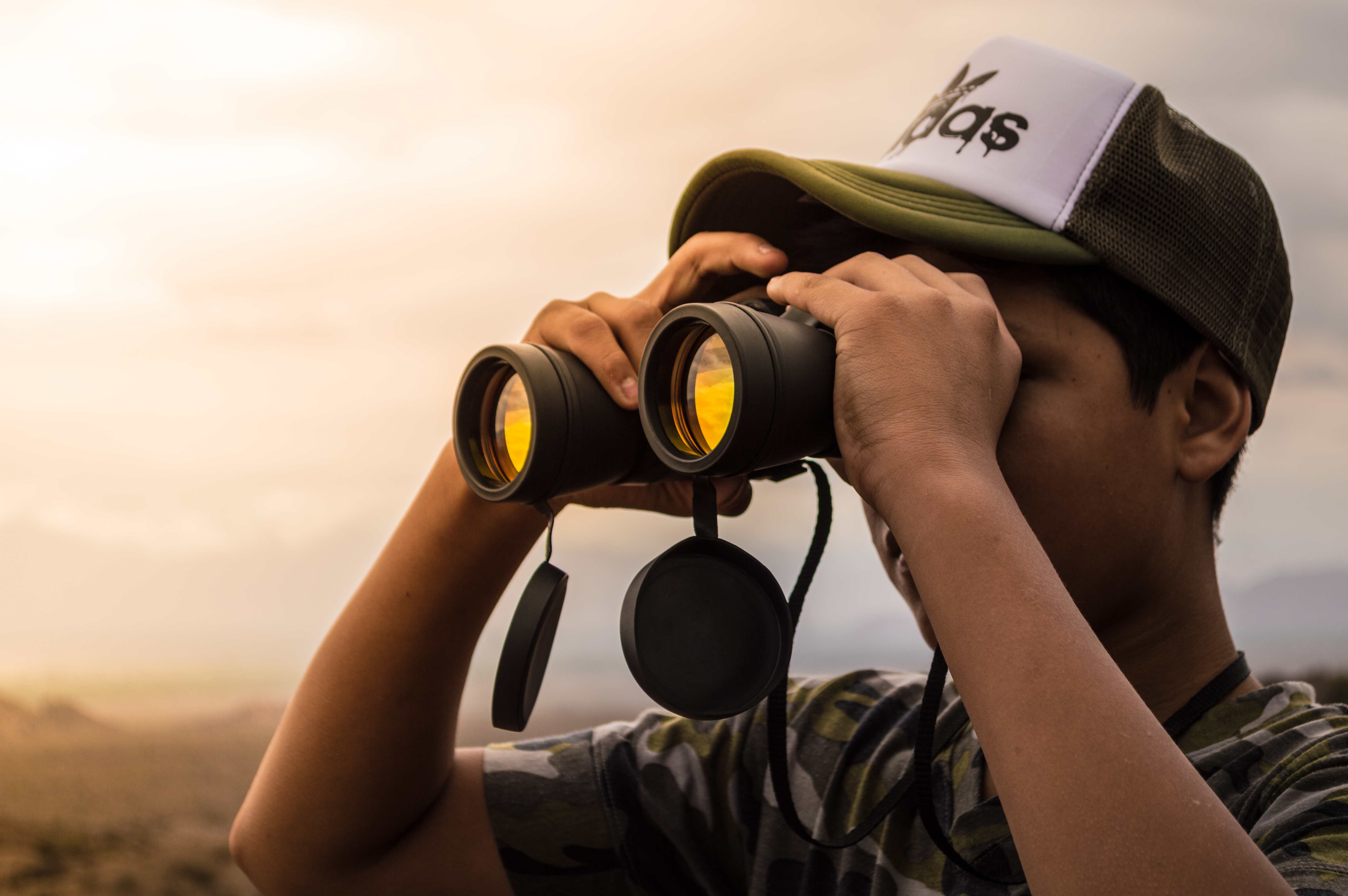 man looking in binoculars during sunset  u00b7 free stock photo